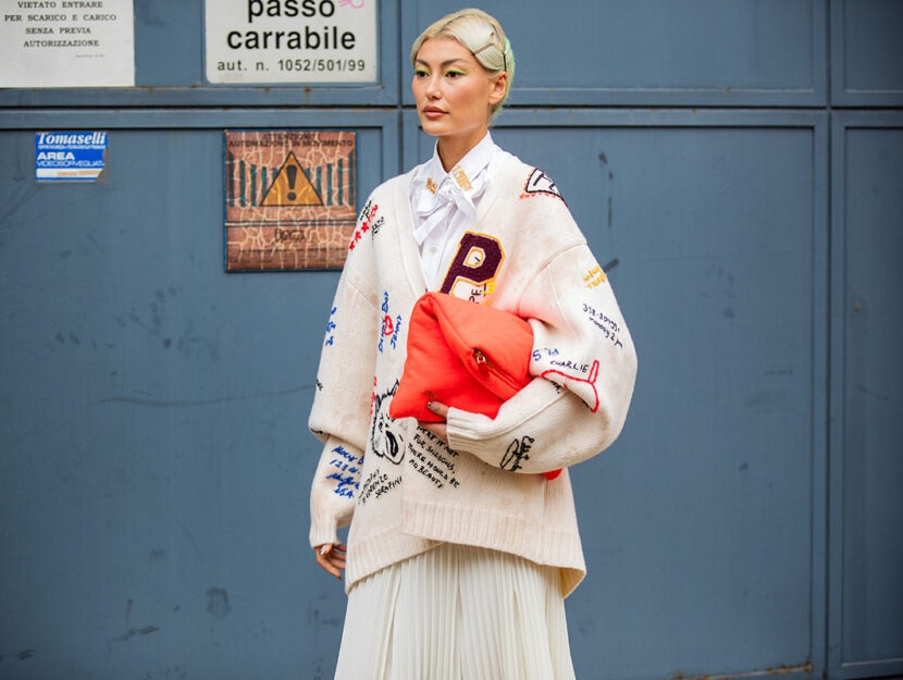 MILAN, ITALY - SEPTEMBER 25: Amalie Gassmann is seen wearing cardigan, red bag, pleated skirt outside Philosophy during the Milan Fashion Week - Spring / Summer 2022 on September 25, 2021 in Milan, Italy. (Photo by Christian Vierig/Getty Images)